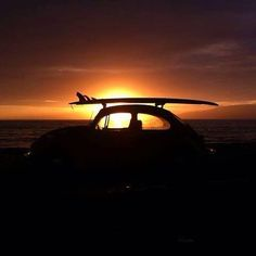 VW Beetle... A surfboard... And a stunning  Sunset... Priceless.......