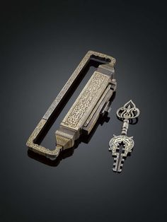 """incredibly ornate inlaid gilt bronze lock & key, likely used to lock the entrance to a harem in a wealthy Ottoman nobleman's home. Intricate calligraphy on the lock as well as key is a passage from the Koran warning intruders that the inhabitants were protected by God's blessings. 12"""" long. c.1800"""
