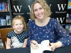 Poppy helps me sign books in Waterstones Lincoln.