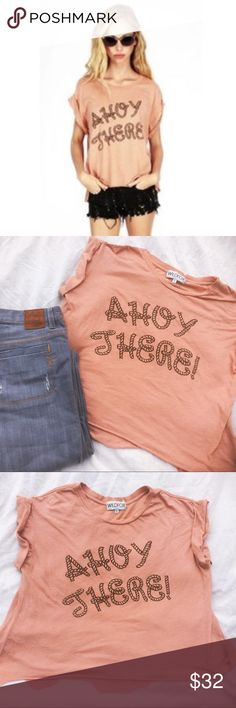 Wildfox Ahoy There Cuffed Tee Wildfox Ahoy There Cuffed sleeve tee with shark tooth hem (see photo of rear for best view). Soft cotton tee in a salmon color with brown rope text. Size Small. No tears or snags. Great with shorts, wide leg jeans, or a denim mini. Wildfox Tops Tees - Short Sleeve