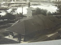 Looking north from the Flint P. Smith (later Sill) building in downtown Flint, Michigan in 1910. Grand Trunk rail station.