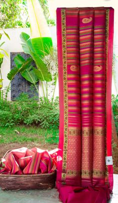 This kanchivaram silk is an ethnic piece in fuchsia pink with multicolour and…