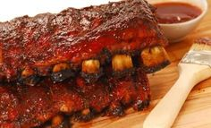 3c pineapple juice 1-1/2c br sugar 1-1/2 T must powder 1/3c ketch 1/3c red wine vin 1-1/2T lemon ju 2T soy sc 1/2t cloves 2t ginger 4 cl garlic, 1/2t cayenne  2# rack ribs 18oz BBQ sc. In dish, mix juice, sugar, mustard, ketchup, vin, lemon, soy. Season w cloves, ginger,garlic,cayenne. Cut into serving size. Cover, marinate in fridge, turn occ, 8hr-overnight. Cook in marinade @ 275 1 1/2hr, turn occ. Lightly oil grate. Grill 15-20mn, basting with sauce, turn freq til glazed.