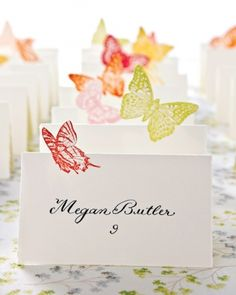 Butterfly Seating Cards: Bride Laura Normandin calligraphed her seating cards, then rubber-stamped each one with a butterfly, which she cut into a silhouette before folding the card.