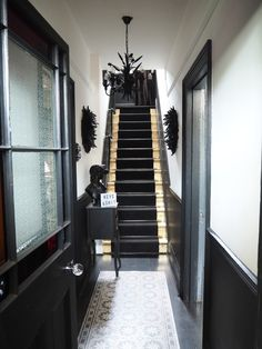 Monochrome Hallway Makeover Reveal - Raspberry Flavoured Windows - Stunning Monochrome Hallway Reveal with gold leaf gilded stairs The Effective Pictures We Offer You - Black And White Hallway, Black Stairs, Black Painted Stairs, Narrow Hallway Decorating, Hallway Ideas Entrance Narrow, Stairs And Hallway Ideas, Narrow Hallways, Modern Staircase, Staircase Design