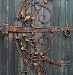 wooden door detail with antique hinge