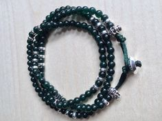 Jade and strerling silver skull charms and disks wrap around bracelet by MastoriJewelry on Etsy