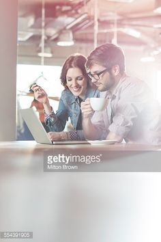 Casual Business People Working At Laptop In Office Stock Photo | Getty Images