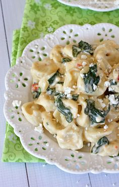 Spinach Alfredo Cheese Tortellini Recipe ~ Cheese tortellini smothered in a rich, creamy spinach and feta alfredo sauce. The entire dish comes together in about twenty minutes making it a great meal without a lot of fuss