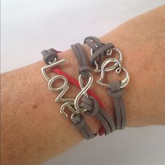 Double Heart infinity bracelet Silver tone grey & red leather. Buy One Get One on these bracelets. In package. New! Jewelry Bracelets