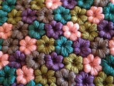 Great way to use up leftover yarn. I found a pattern to make these flower. http://littlegreen.typepad.com/files/mollie-flowers-2-1.pdf ༺✿ƬⱤღ  https://www.pinterest.com/teretegui/✿༻