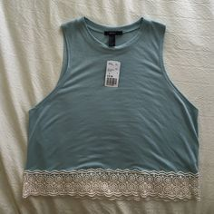 Forever 21 Mint Colored Sleeveless Top with Lace Never worn, New with tags! Beautiful mint/ jade bluish green color tank top with off white floral crochet lace detail on the bottom. Size small Forever 21 Tops Tank Tops