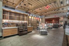 The beautiful, wood acoustic ceilings of Cooper's Hawk Winery & Restaurant are a key feature of their signature retail space. They absorb the noise while harmonizing with the restaurant's Napa Valley style. Product: SoundPly's Lino Acoustic Ceiling Planks Architect: Aria Group Architects, Inc. Installer: Southeast Woodcrafters Wood Ceiling Panels, Wood Ceilings, Napa Valley Style, Napa Restaurants, Cooper's Hawk, Energy Use, Acoustic Panels, Retail Space, Showcase Design