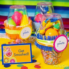 Send your guests home with ¡olé!-inducing pinata party favors! Take two plastic cups, filling one with colorful crepe streamer confetti and the other with candy fruit and bubble gum. Carefully place the candy-filled cup upside-down over the confetti cup so the treats rest on top of the confetti. Wrap where the cups meet with fringe-cut streamers, curling ribbon and a favor label. Place your treats by the door with a fiesta-colored place card that encourages your amigos to take a whack!