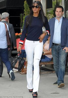 Looking fresh: Naomi Campbell was pictured looking sartorially stunning in white flares and a jumper as she walked around Manhattan the day after the 2015 Met Gala on Tuesday