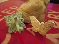 The 'Putty' Hook and one of the white 'Flutterby' knobs.— at Della's Workshop