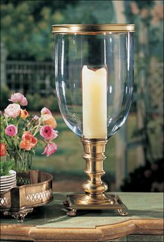 brass and crystal hurricane lamp with paw feet and hand blown crystal chimney
