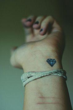 tiny blue diamon tattoo