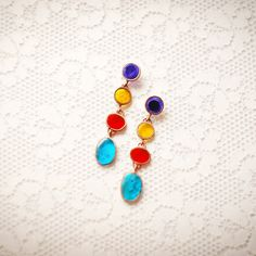 Long bright stud earrings. With violet, yellow, red and blue colors. Beautiful studs. Suits to different types of clothes. Made in Ukraine. Hand made jewelry.