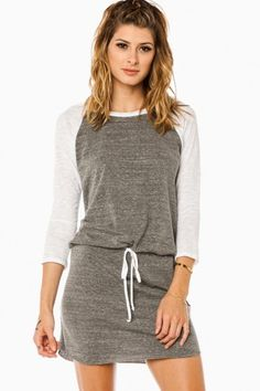 A super soft jersey dress accented with charming baseball-style sleeves. Drawstring waist, 3/4 sleeves.