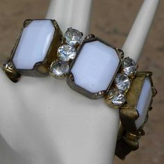 Fashion white stretch bracelet with large faceted plastic white stones and sparkling clear diamante This modern white bracelet is set into gold colour frames that have a little patination Previously owned circa 2000s