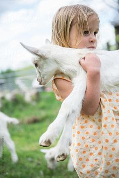 Stock photo of Little farm girl carries a baby goat in her arms by cara Animals For Kids, Farm Animals, Cute Animals, Country Life, Country Girls, Country Living, Country Charm, Cute Kids, Cute Babies