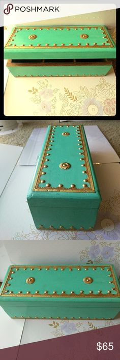 💙💙 Must have turquoise, brass and wood box 💙💙 This rectangular box is one of a kind. It's made of sturdy oak wood painted in a turqiuise paint. It has a hinge opening and there separate 3 compartments inside. The exterior of the box is embellished with gold colored brass studs and accents. This box can be used for literally anything. It's very versatile. It can be a jewerly box, a tea box, a planter or just a nice decorative piece.   The dimensions are 10 inches long, 4 inches in height…