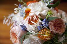 Springtime bouquet of jasmine, gardenias, garden roses, muscari and ranunculus.