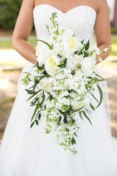 white and green bouquet - photo by Courtney Dox Photography http://ruffledblog.com/romantic-southern-wedding-in-south-carolina #weddingbouquet #flowers #bouquets