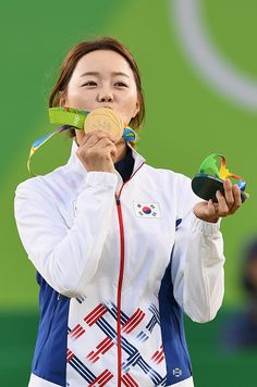 Hyejin Chang of Korea celebrates winning gold in the Women's Individual Round on…