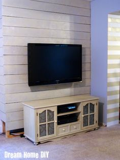 You get an accent wall and a mounted TV with no visible cords. Great idea!