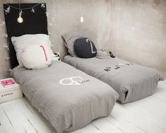 Concrete walls and 1, 2 pillows. Love this look.