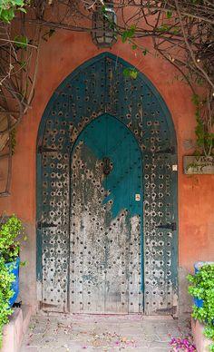Weathered teal door of Majorelle Garden in Marrakech, Morocco door by Ronald Santerre~
