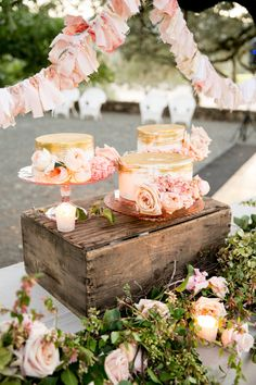 Instead of a stacked cake, the couple served three individual cakes topped with blush buttercream and dusted with gold on top.