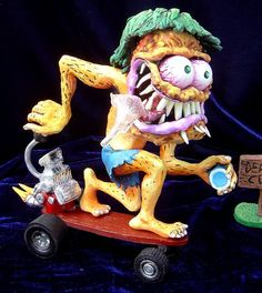 "Ed ""Big Daddy"" Roth Surfing Surfer Scultpure Statue  Weblink: http://www.ratfink.com/  Facebook Page: https://www.facebook.com/Ed-Big-Daddy-Roth-1658868147702395/?fref=ts   · Updated 23 hours ago"
