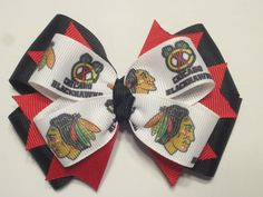 chicago blackhawks inspired triple layer boutique style hockey hairbow  (4 1/2 inch). $6.45, via Etsy.