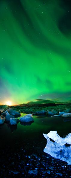 15 reasons why Norway will Rock your World | 7. Incredible strong northern lights during moon setting behind glaciers, Norway