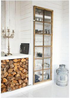 exposed firewood storage* rustic pantry door* antique candelabra