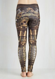 These printed leggings are well-equipped with eye-catching style in which to tackle your next journey! Smooth, sturdy fabric supports a realistic, steampunk-inspired print of cogs, gears, watches, and buckled straps, making for a bold setup that matches your adventurous style!
