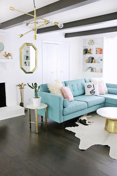 I love everything about this room -- light fixture, sofa, wood floors, rug, cat