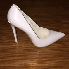 White heels Brand new white heels 4.5 inch heel will come without original box Shoes Heels