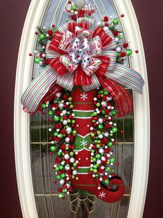 "Christmas Wreath Door Wreath Teardrop Vertical Swag Decor..""Glitter Stocking"". $105.00, via Etsy."