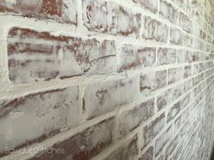"""German Schmear"" technique l A statement that adds a whole lot of character. Materials needed: Brick Paneling ($25 a piece) Wall Spackle ($6 per quart) White Wash (It averaged out to be about 1 quart of spackle per 4'x 8′ panel)"