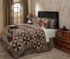 Providence Quilt Collection features a traditional pinwheel pattern in tan, navy blue and dark red plaid fabrics. Quilt reverses to a tan and navy blue ticking stripes. ~KD Home Fashions