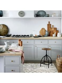 A beautiful modern kitchen with rustic touches. Nordic Sea tableware, berber style rug & industrial kitchen stool by broste Copenhagen Home Interior, Kitchen Interior, New Kitchen, Kitchen Dining, Kitchen Decor, Kitchen Cabinets, Interior Design, Kitchen Without Wall Cabinets, Marble Kitchen Ideas