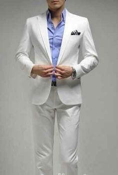 groom in white maybe with white or colored shirt and orange, green or blue accents. when you decide on colors