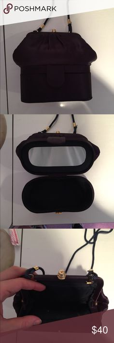 Navy Evening Bag Navy with gold hardware evening bag. Has two opening with the bottom half containing an interior mirror. Previously worn but In excellent condition! Open to reasonable offers through feature! Bags