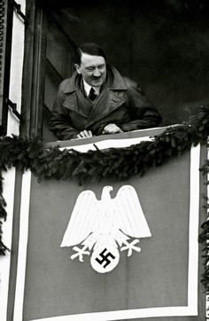 Hitler at Garmisch-Partenkirchen during the Winter Olympics leaning out of his hotel room at the Olympia Haus (February 1936)