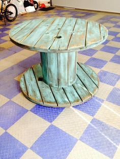 Electrical Spool made into table for Local Yoga Studio. Lots and lots of sanding! Painted with Behr Aqua Rapids, distressed and waxed with light wax. Beware of splinters! Electrical Spool made into table for Local Yoga Studio.