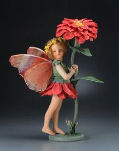 The newest tiny felt creation from R. John Wright. the Zinnia Fairy from The Flower Fairies Collection®